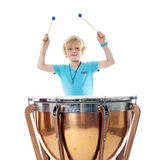 Young blond boy playing kettle drum Stock Image
