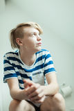 Young blond boy sat on toilet Royalty Free Stock Photo
