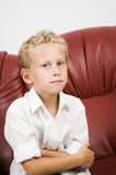 Young blond boy on sofa Royalty Free Stock Photos