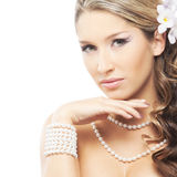 A young blond bride posing in beautiful makeup Royalty Free Stock Photos