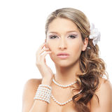 A young blond bride posing in beautiful makeup Stock Image