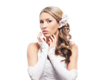 A young blond bride posing in beautiful makeup Stock Images