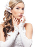 A young blond bride posing in a white dress and makeup Royalty Free Stock Image