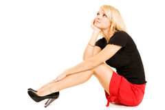 Young blond business woman relaxing and dreaming. Hi key Royalty Free Stock Image