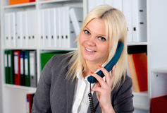 Young blond businesswoman is calling Stock Photo