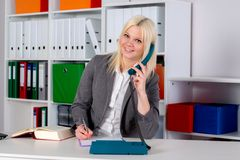Young blond businesswoman is calling Royalty Free Stock Photos