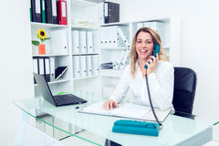 Young blond businesswoman calling Stock Photo
