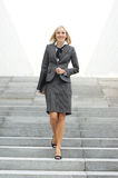 A young blond businesswoman in formal clothes Stock Photos