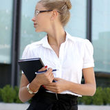 A young blond businesswoman in formal clothes Stock Photo