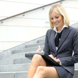 A young blond businesswoman in formal clothes Stock Photography