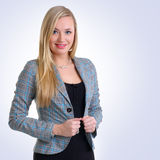 A young blond businesswoman in formal clothes Stock Images