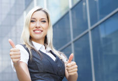 A young blond businesswoman holding thumbs up Royalty Free Stock Images