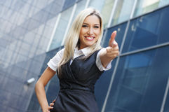 A young blond businesswoman holding thumbs up Stock Images