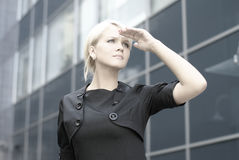 A young blond businesswoman is looking forward Stock Images