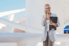 Young blond businesswoman wearing glasses stock images