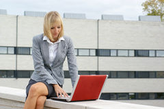 A young blond businesswoman working on the laptop Royalty Free Stock Photos
