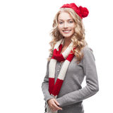 Young blond casual woman in red scarf and hat. Young blond smiling casual woman in red scarf and hat Stock Image
