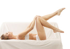 A young blond Caucasian woman laying in lingerie Royalty Free Stock Photography