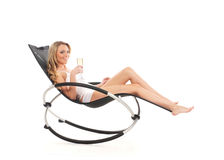 A young blond Caucasian woman relaxing in a chair Royalty Free Stock Photos