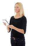 Young blond caucasian woman using tablet computer Stock Photos