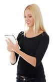 Young blond caucasian woman using tablet computer Royalty Free Stock Photos