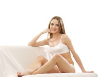 A young blond Caucasian woman in white lingerie Stock Images