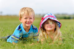 Young blond children in field Royalty Free Stock Photography