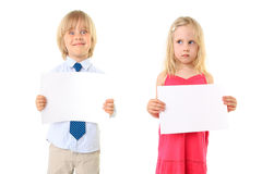 Young blond children holding a blank sign board Stock Image