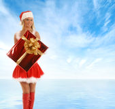 A young blond in a Christmas suit with a present Stock Photo