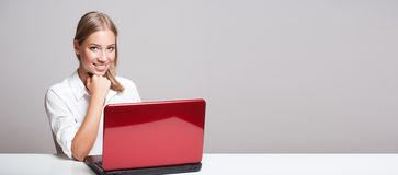 Young blond computer user. Royalty Free Stock Images
