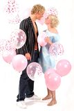 Young blond couple in love. Studio shot with balloons Royalty Free Stock Image