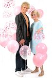 Young blond couple in love. With balloons Royalty Free Stock Photography