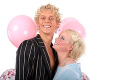 Young blond couple in love. She is looking to him Royalty Free Stock Photos