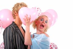 Young blond couple in love. And having fun with balloons Stock Image