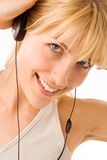 Young blond with earphones Royalty Free Stock Image