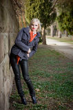 Young blond fashion model outdoors. Royalty Free Stock Images