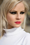 Young blond fashion model posing on the street. Royalty Free Stock Photos