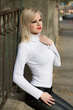 Young blond fashion model posing on the street. Royalty Free Stock Photography