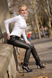 Young blond fashion model posing on the street. stock photo