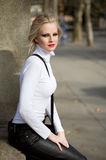 Young blond fashion model posing on the street. Royalty Free Stock Images