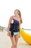 Young blond female with pony tail  in life jacket Stock Photos