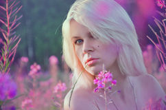 Young blond with flowers Stock Photography