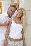 Young blond german couple in summer holiday in white clothes. Royalty Free Stock Image