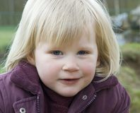 Young blond girl. A young blond girl smart looking Royalty Free Stock Photography