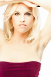 Young blond girl. Portrait of young sexy blond girl isolated on white Stock Photo