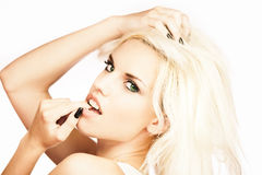 Young blond girl. Portrait of young sexy blond girl isolated on white Stock Images