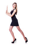 Young blond girl in black dress pushing isolated Stock Photo