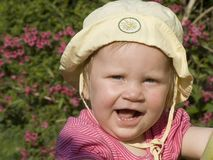 Young blond girl calling Royalty Free Stock Photo