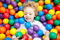 A young blond girl child having fun Royalty Free Stock Images