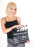 Young blond girl with clapper board Stock Images